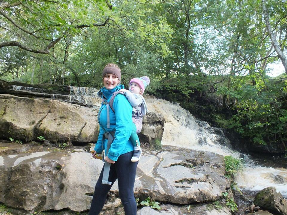 mother hiking wearing baby in boba x baby carrier